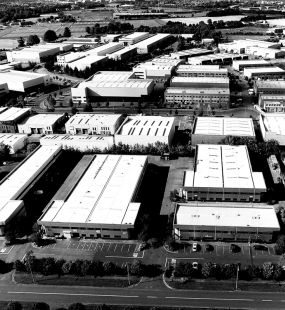Industrial estate warehouse buildings birdseye view - DUAL Oliva Property & Casualty